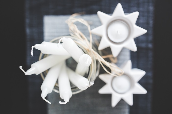 photo; white holiday decorations and candles